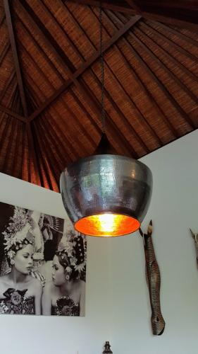 Hand beaten copper pendant lighting - Villa Koru