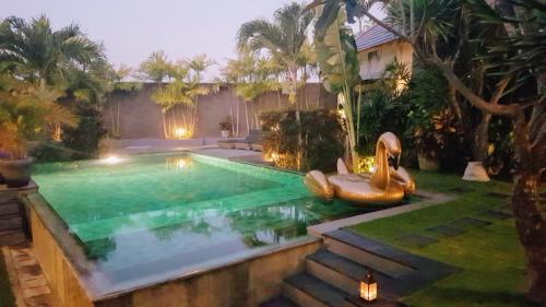 Swan Floatie in Swimming Pool - Villa Koru